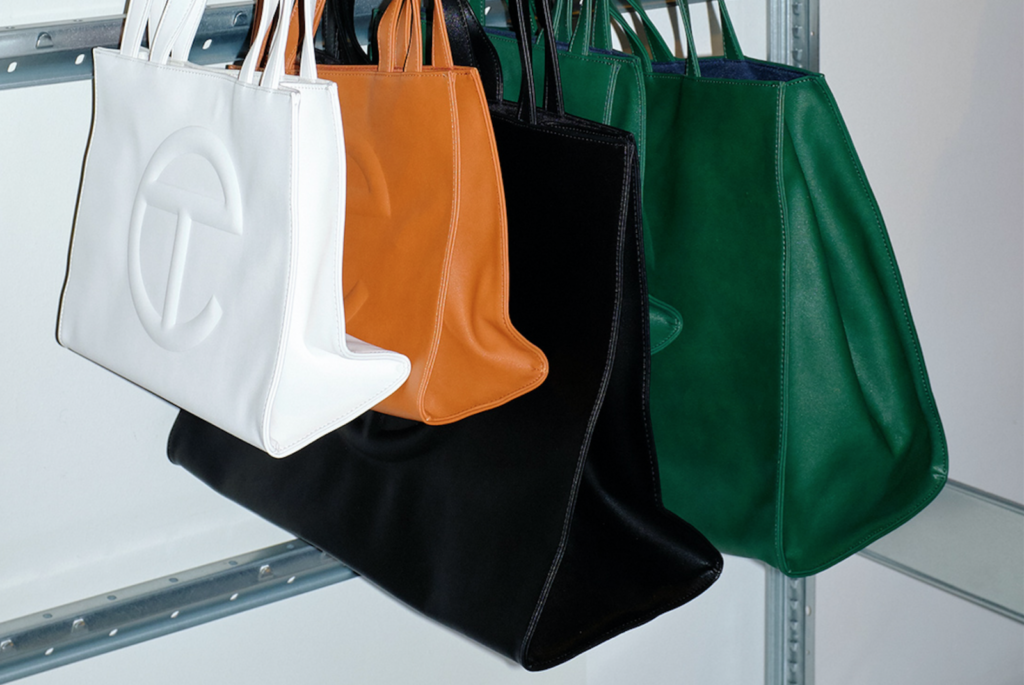 "Guess is Coming Under Fire for Knocking-Off Telfar's Cult ""Shopping Bag"""