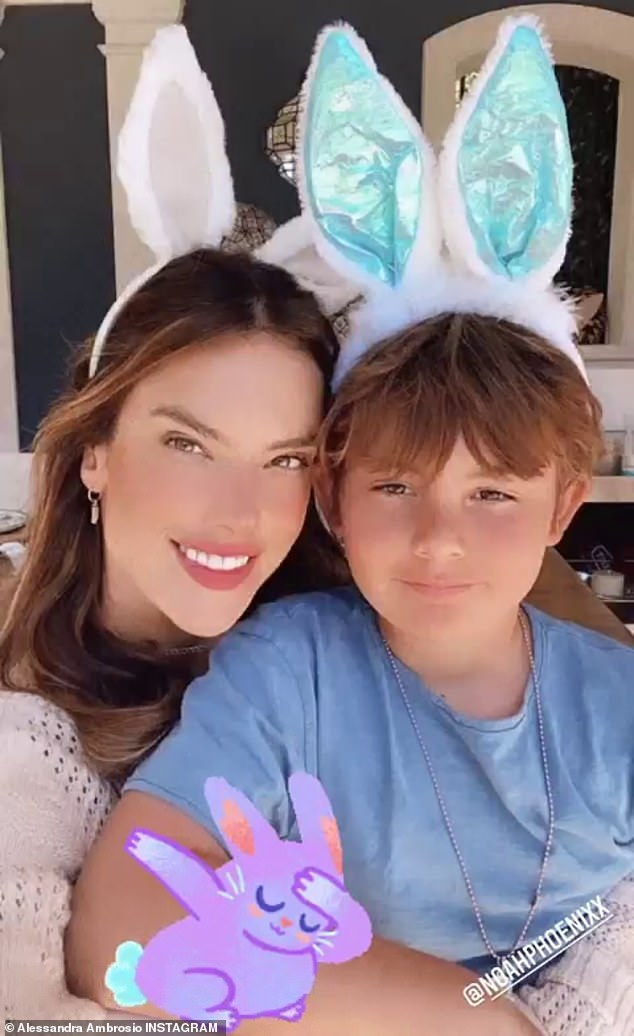 Easter spirit: Ambrosio also snuggled up with her son while wearing bunny ears