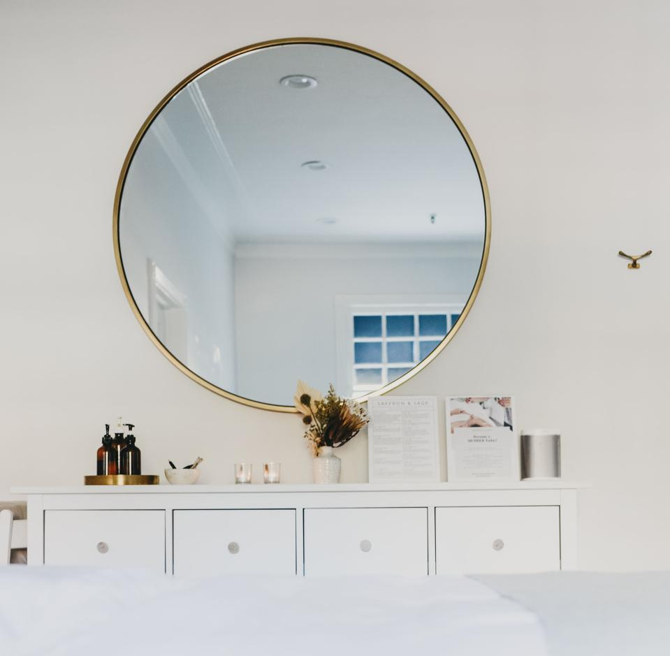 A spa room with a mirror at Saffron and Sage.