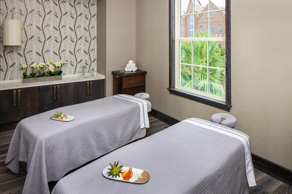 Two massage tables at a spa treatment facility.