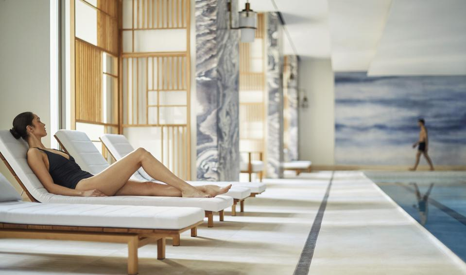 A woman at the pool at the New York Four Seasons Hotel.