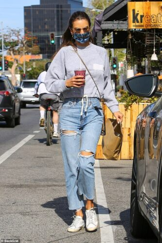 Alessandra Ambrosio keeps it casual-cool in blue jeans and sweatshirt while out grabbing food to-go