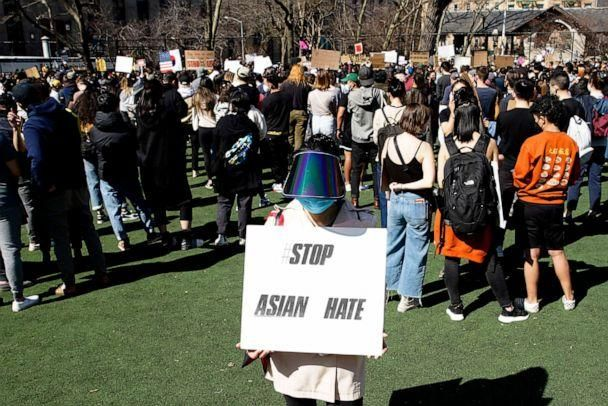 PHOTO: A woman holds a placard during a rally against Asian hate at Columbus Park in Chinatown on March 21, 2021, in New York. (View Press/Corbis via Getty Images)